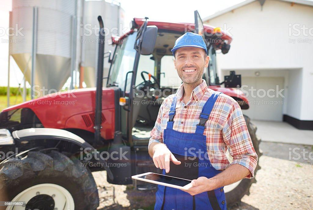 Modern farmer on his mechanized farm stock photo