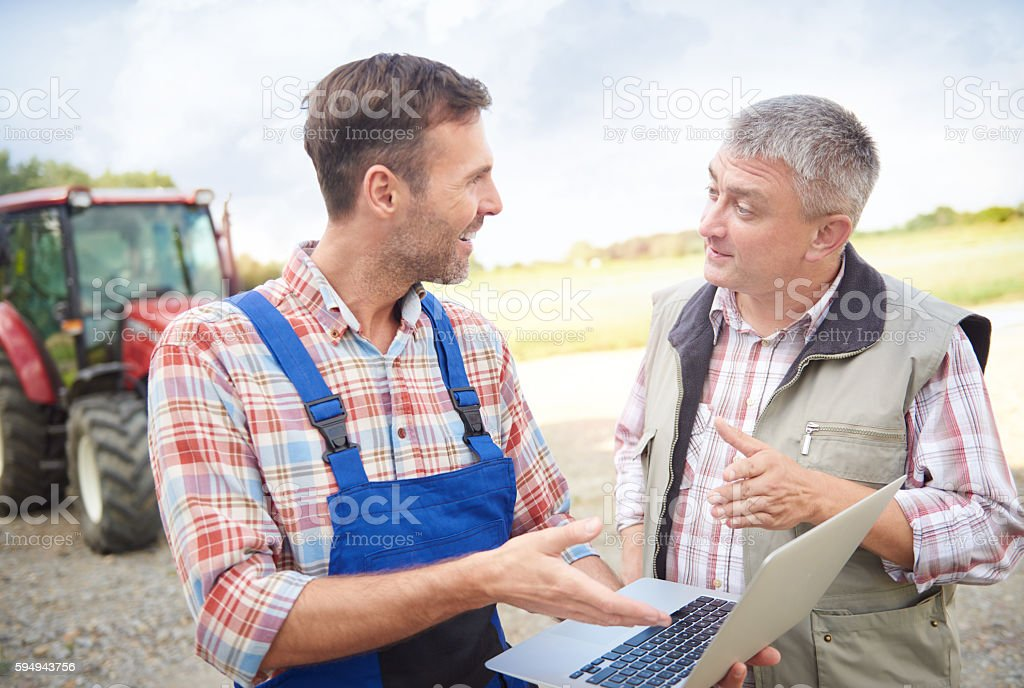 Modern farmers over the laptop stock photo
