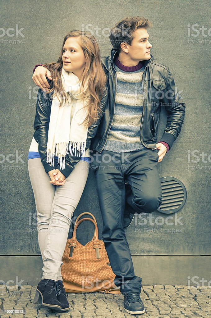 Modern fashion Couple in a moment of mutual Disinterest stock photo