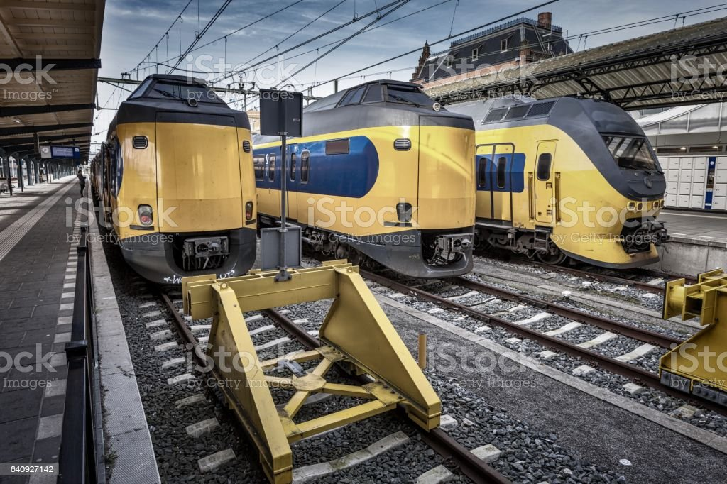 Modern fast intercity trains on Central Station in Groningen waiting at the platform to leave for Amsterdam. The intercity trains are an efficient and reliable connection between the north and the west (Randstad) of Holland stock photo