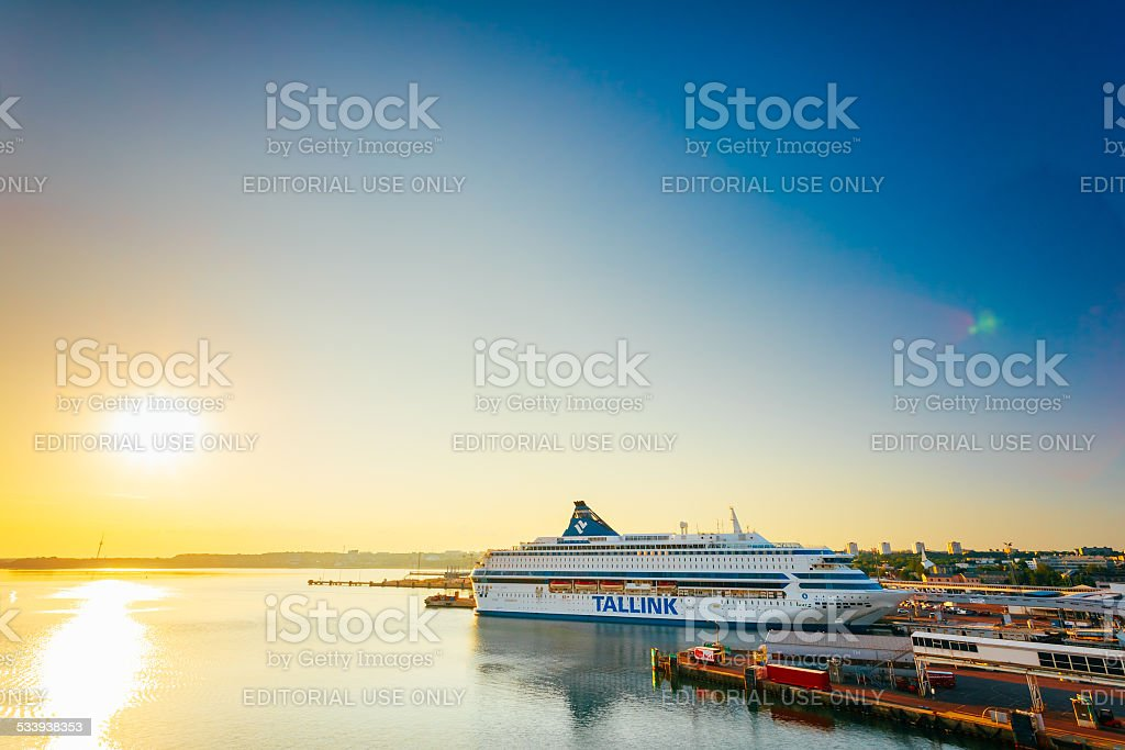 Modern Ferry At Pier. Early Morning With Beautiful Sunrise Sky, stock photo