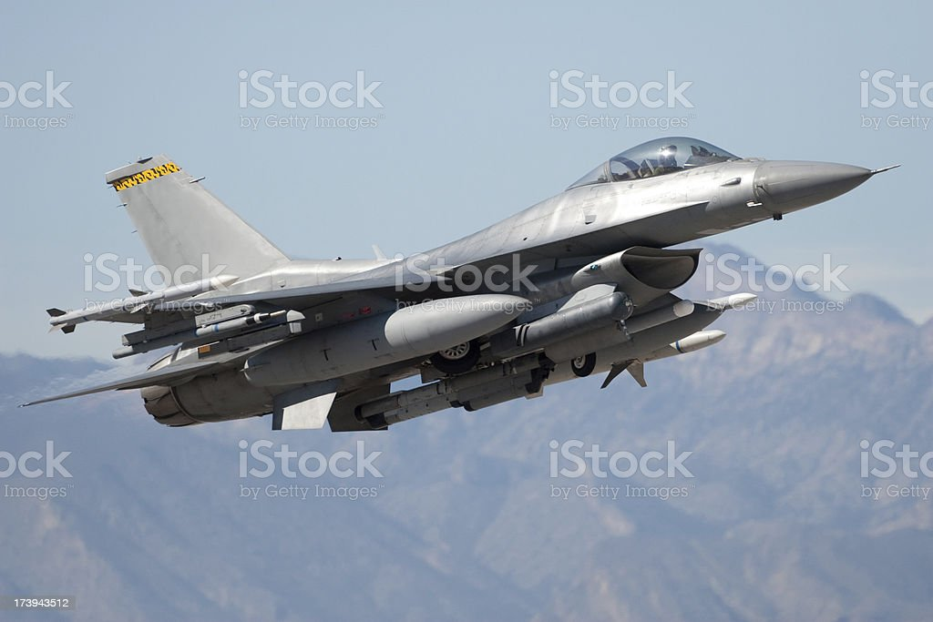 Modern fighter jet flying in the sky stock photo
