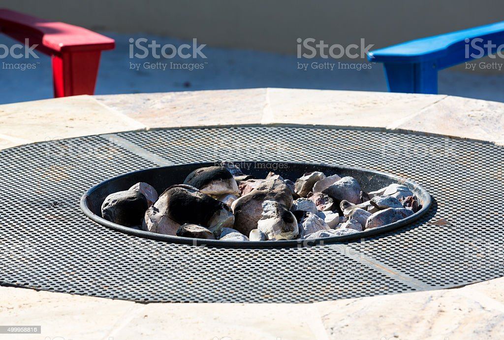 Modern firepit with white hot coals stock photo