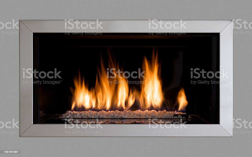 modern fireplace set in a wall stock photo