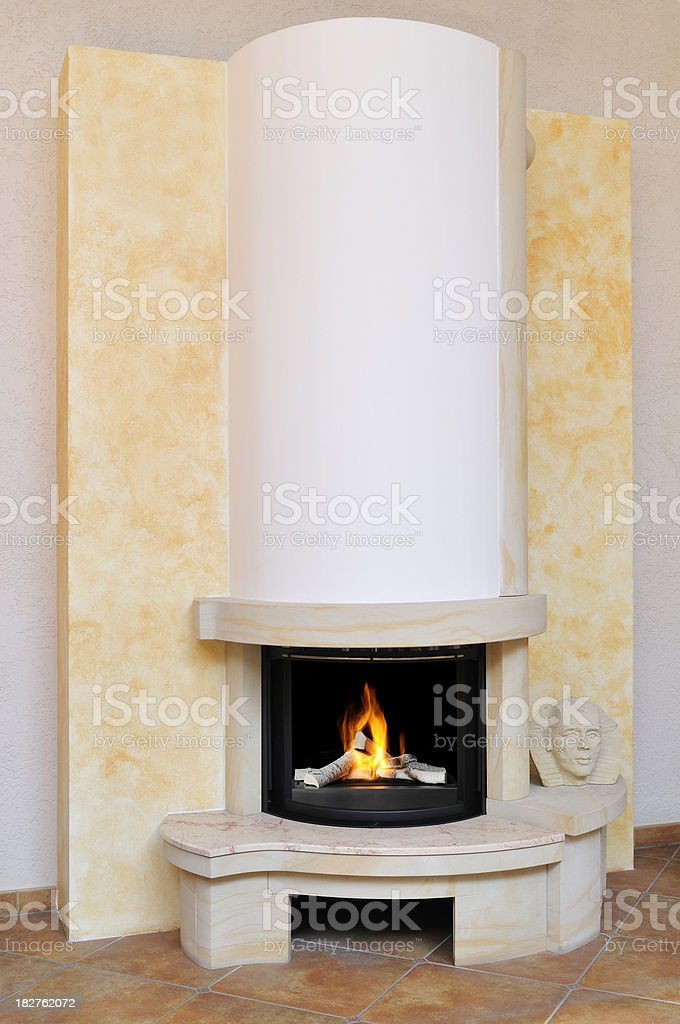 Modern fireplace with ceramic woods in classical style, living room royalty-free stock photo