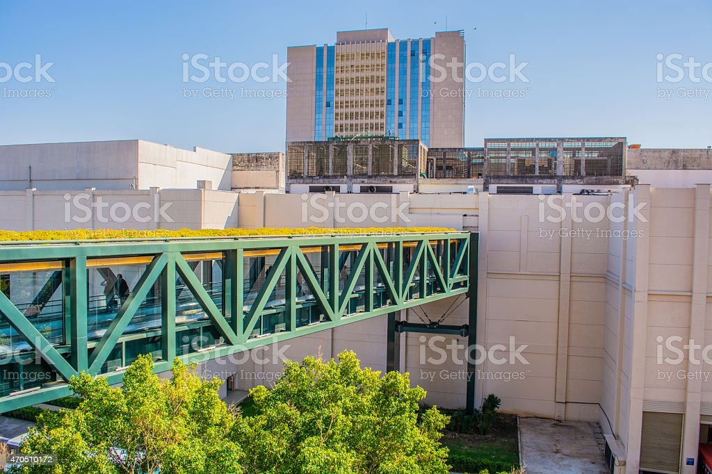 modern footbridge grass wall of shopping building stock photo