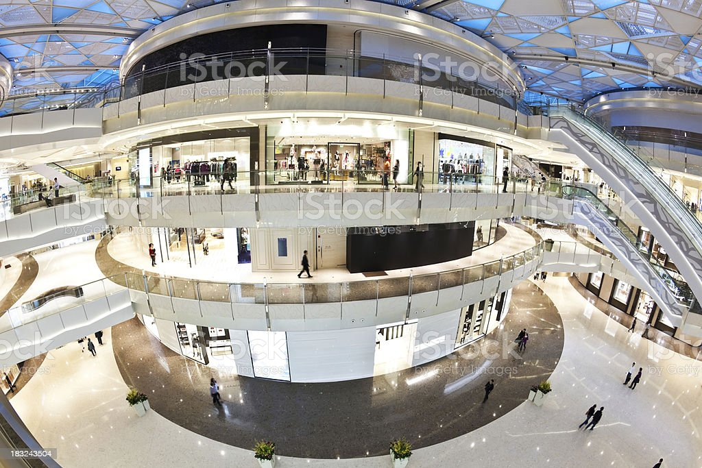 Modern four story shopping mall with general white accents stock photo