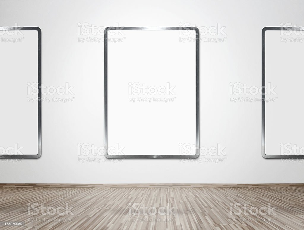 Modern gallery interior with blank frames royalty-free stock photo