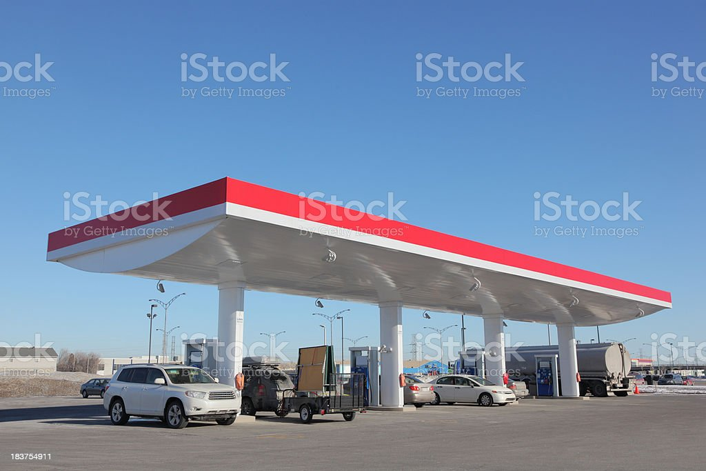 Modern Gas Station with cars refueling stock photo
