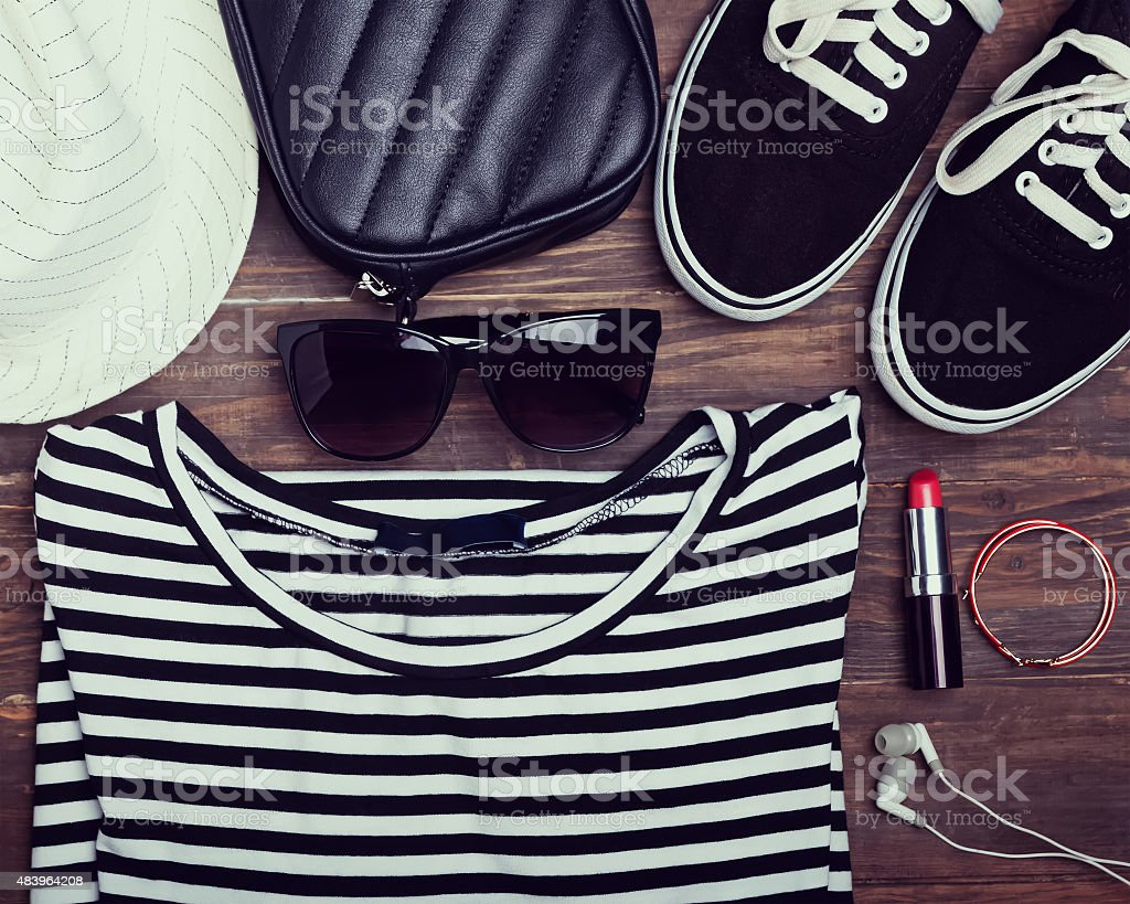 Modern girl outfit on wooden background, retro toned photo stock photo