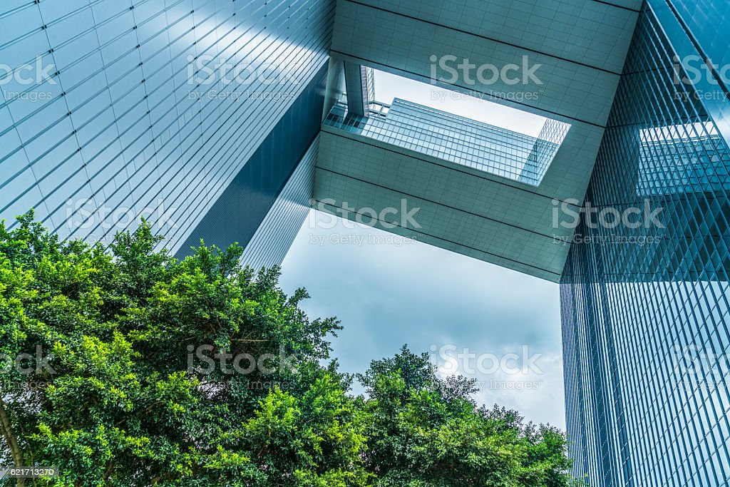 modern glass building and green leaves stock photo