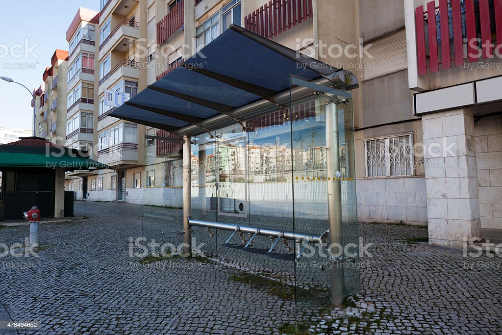 Modern glass bus stop in Portugal stock photo