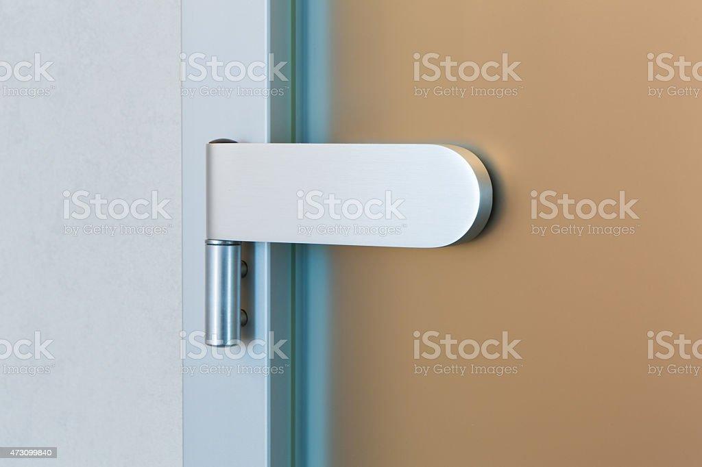 Modern glass door hinge stock photo