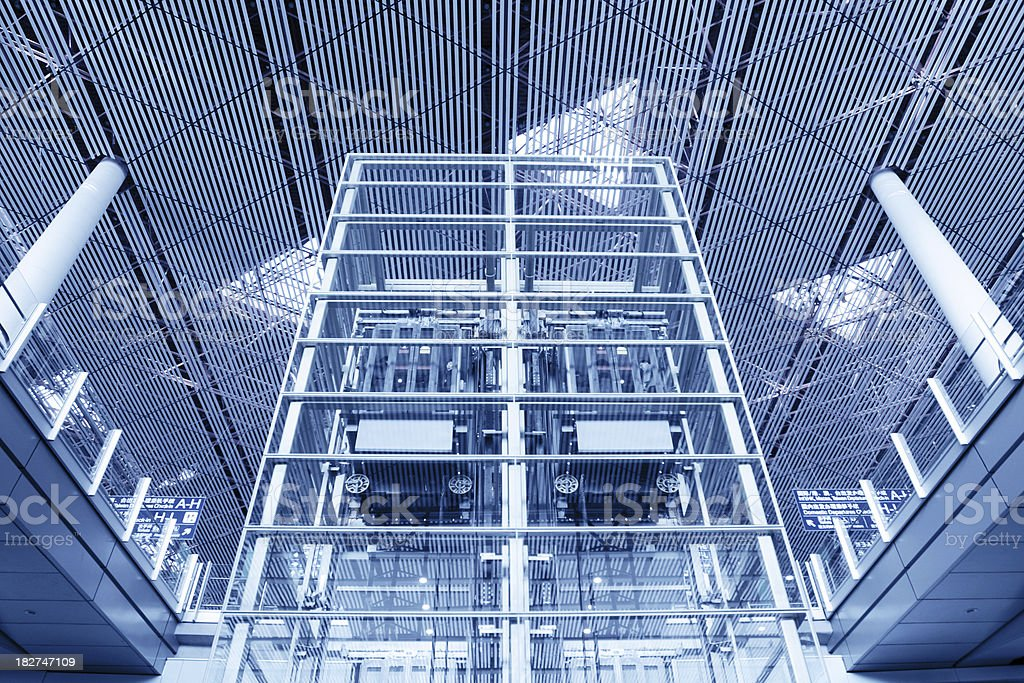 Modern Glass Elevator in Beijing Airport Hall - XLarge royalty-free stock photo