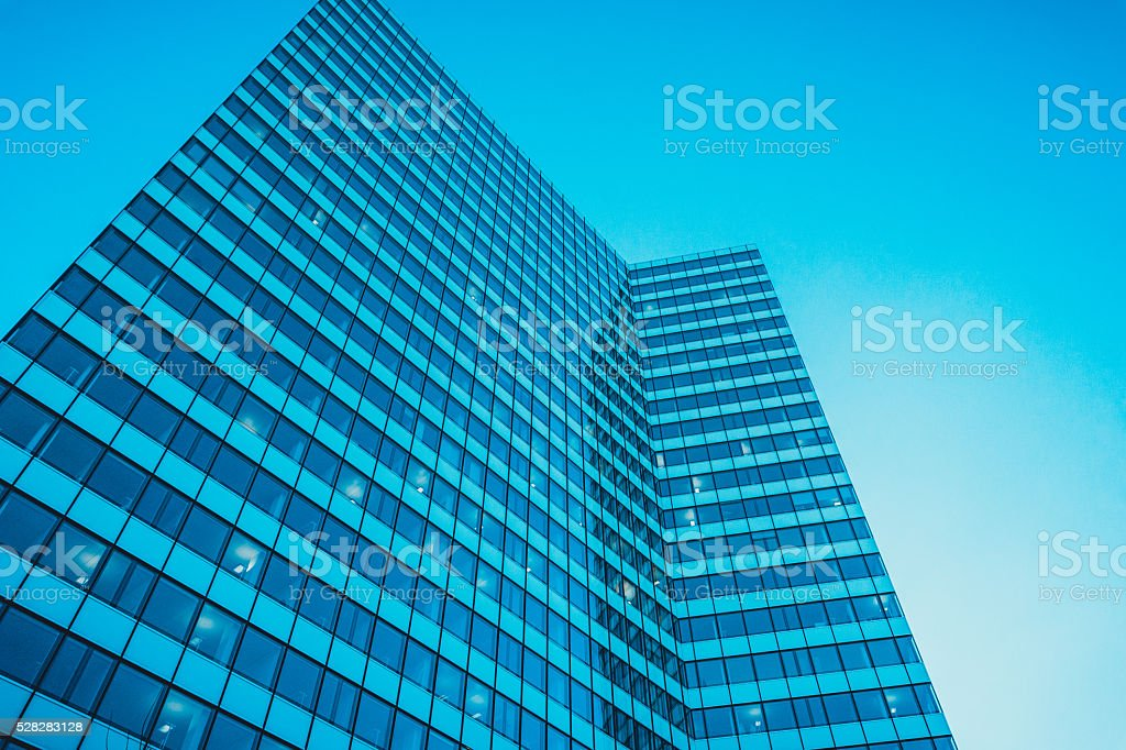 Modern glass fronted facade of an office block stock photo