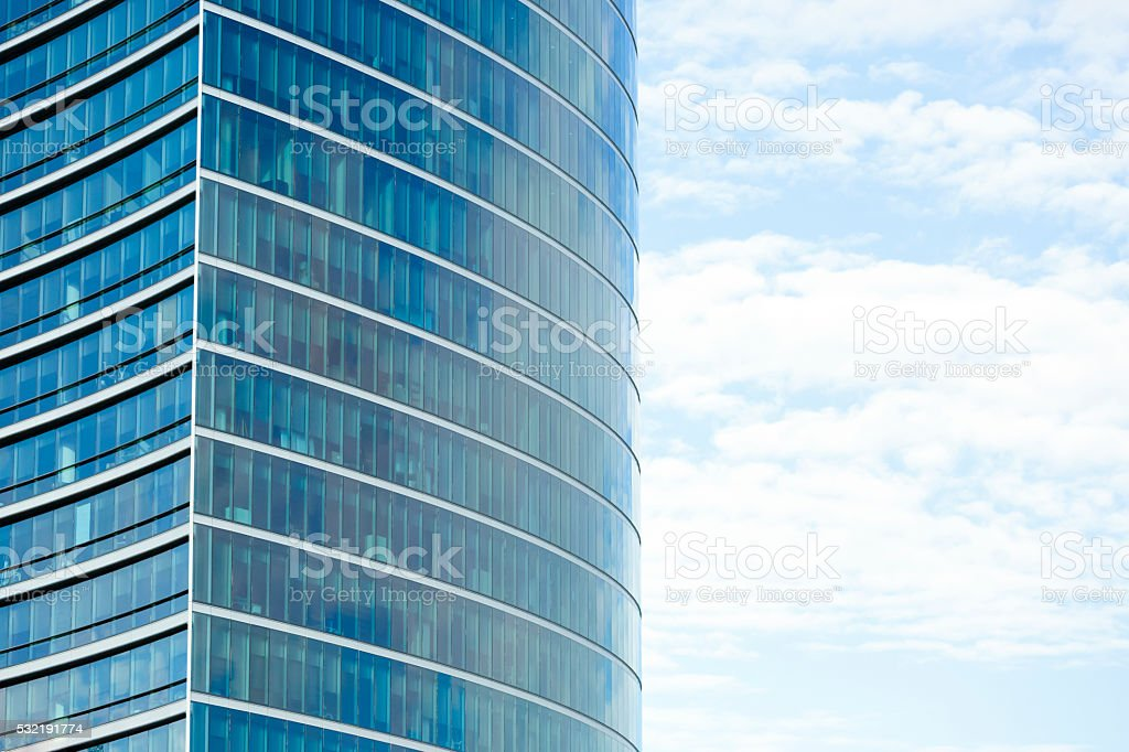 Modern glass office building with reflection of sky, copy space stock photo