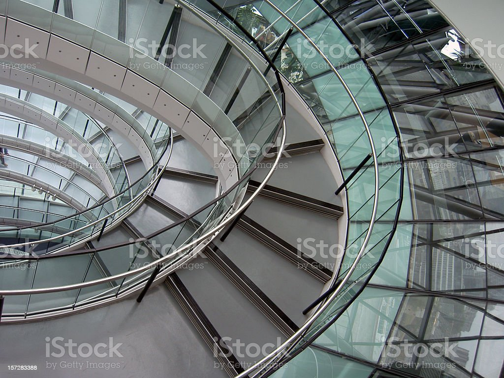 Modern glass spiral staircase with windows  royalty-free stock photo