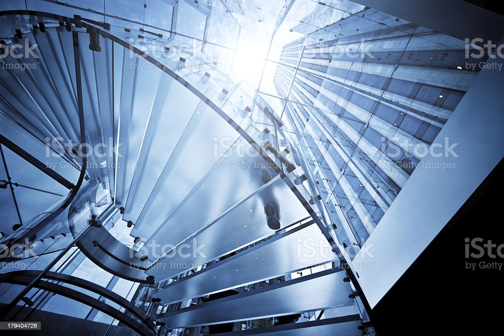 Modern Glass Staircase with Silhouettes of People royalty-free stock photo