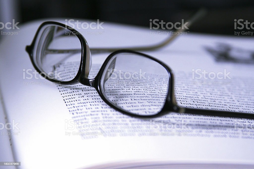 Modern Glasses Resting on Open Book royalty-free stock photo