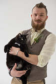Modern groom and his cat