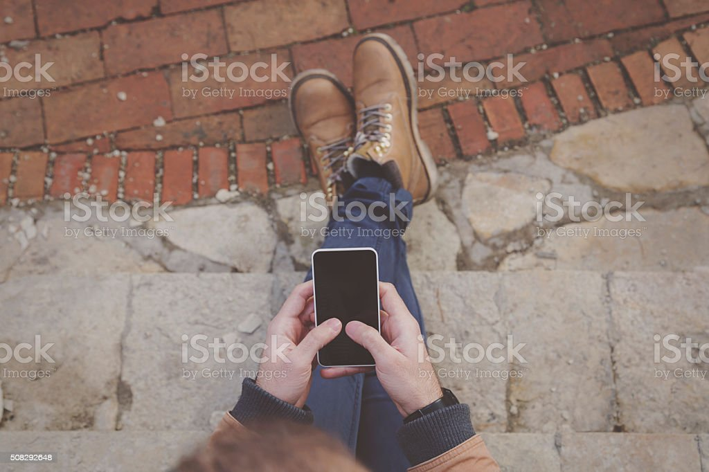 Modern guy typing on a smartphone. stock photo