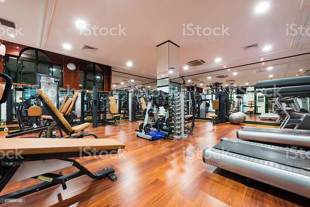 Modern gym featuring different exercise equipment stock photo