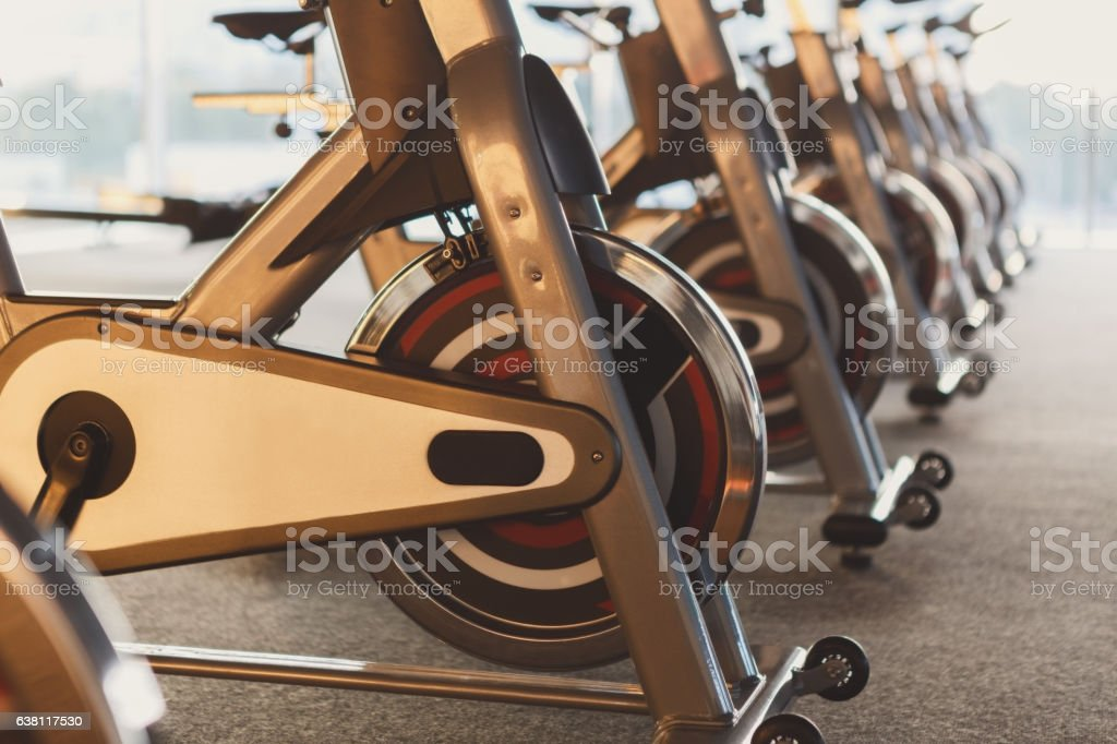 Modern gym interior with equipment, fitness exercise bikes stock photo