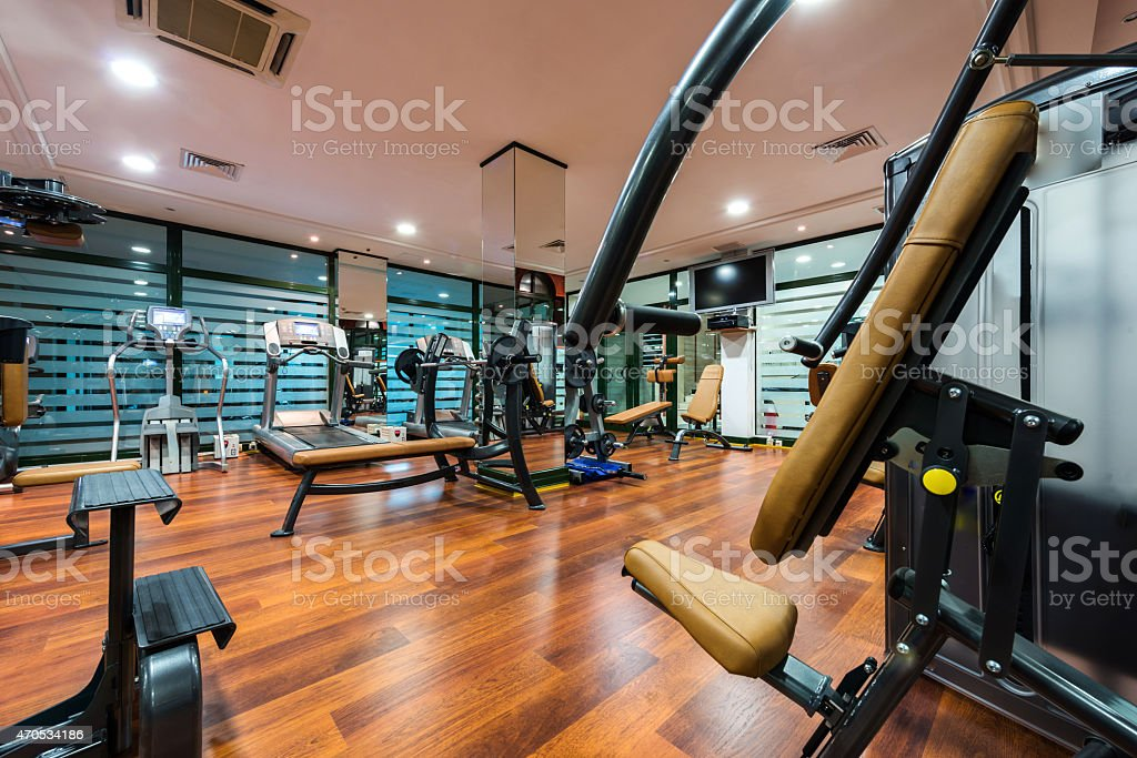 A modern gym with a lot of workout equipment stock photo