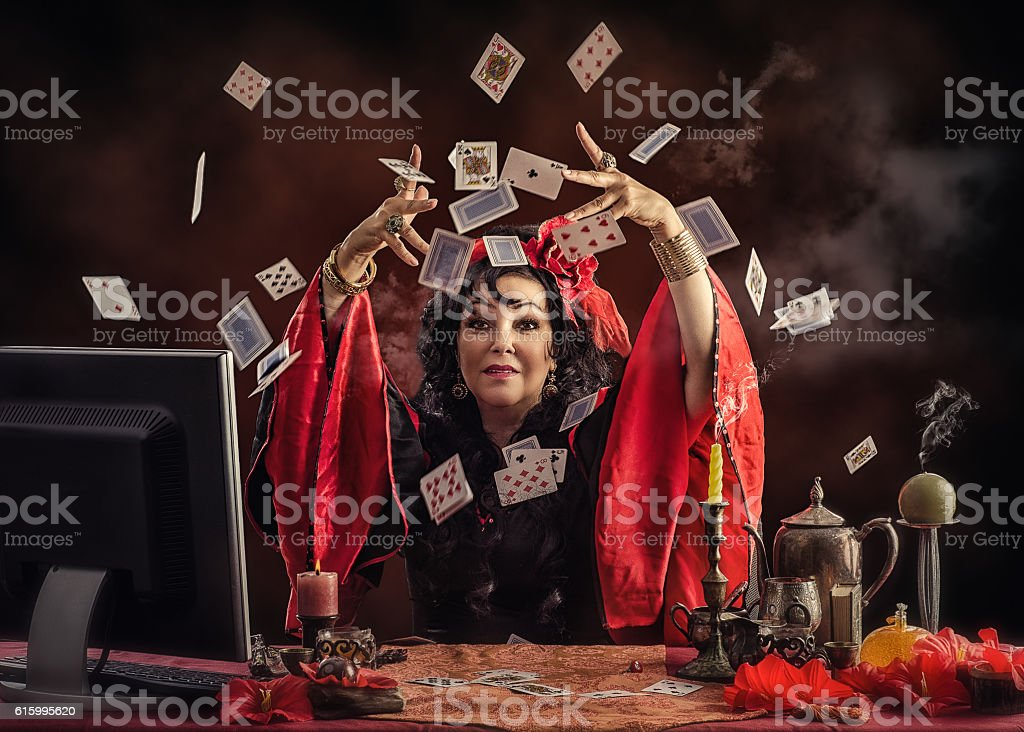 Modern Gypsy soothsayer tossing up playing cards stock photo