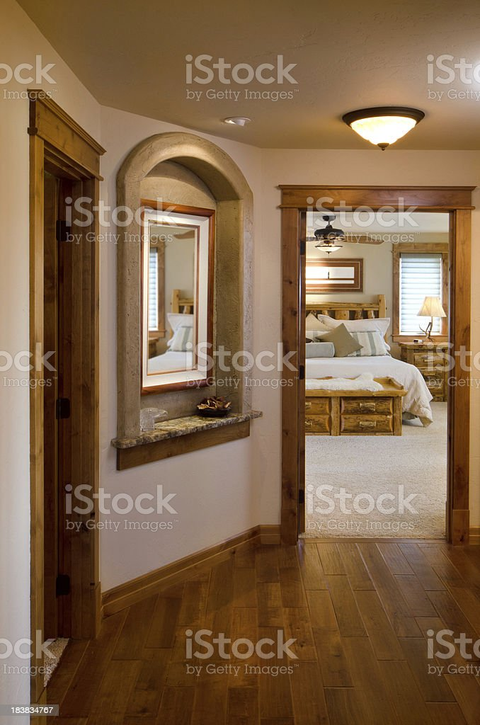 Modern hallway with view of master bedroom royalty-free stock photo
