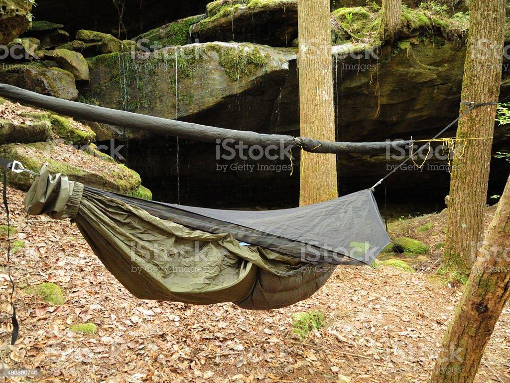 modern hammock hanging near rock shelter stock photo   - modern hammock hanging near rock shelter royaltyfree stock photo
