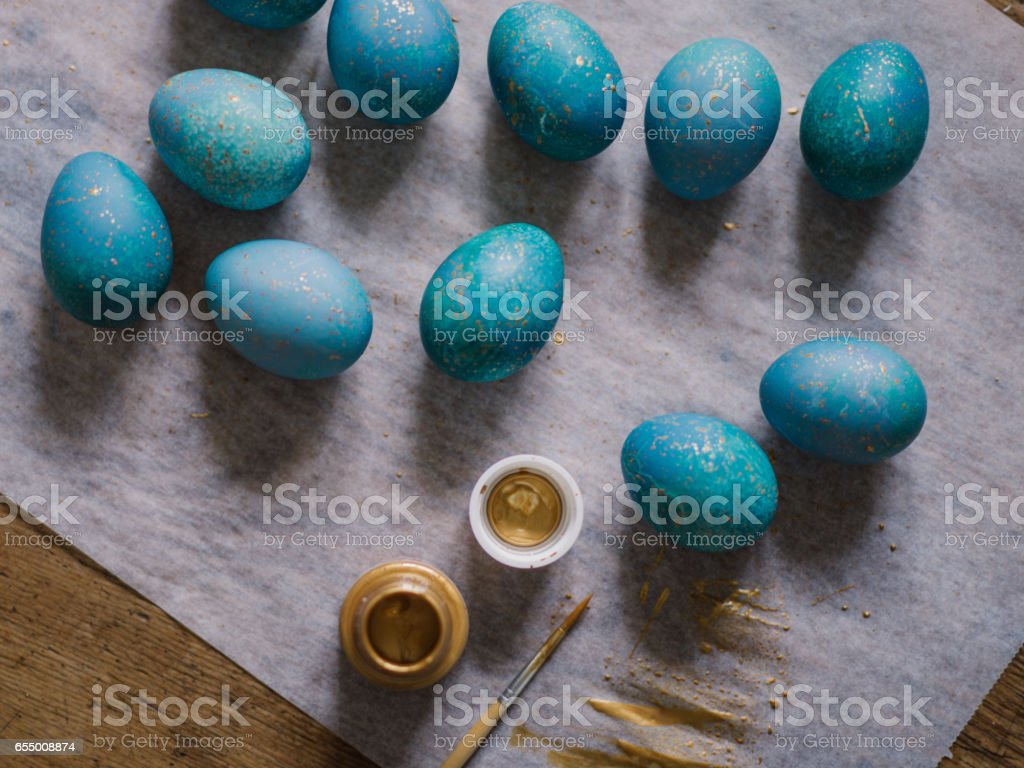 Modern hand dyed blue easter eggs stock photo