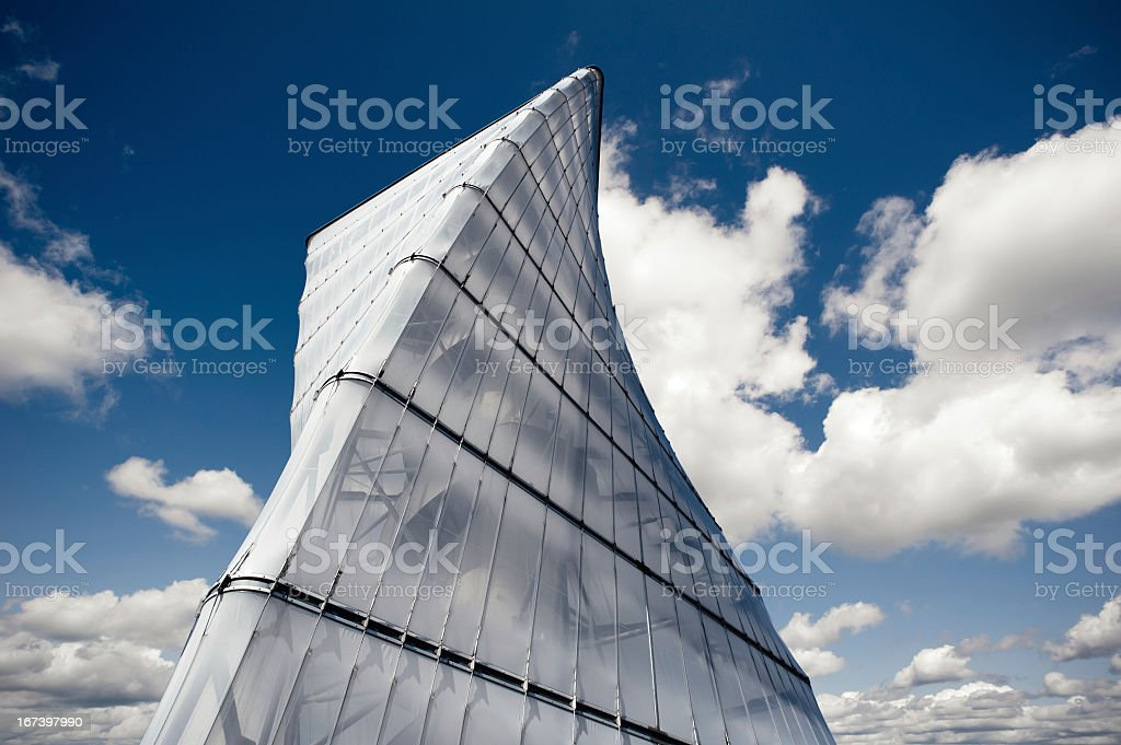 Modern helix tower with blue cloudy sky royalty-free stock photo
