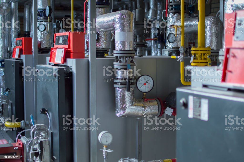 Modern high power industrial gas boilers with natural gas burners in the gas boiler plant stock photo