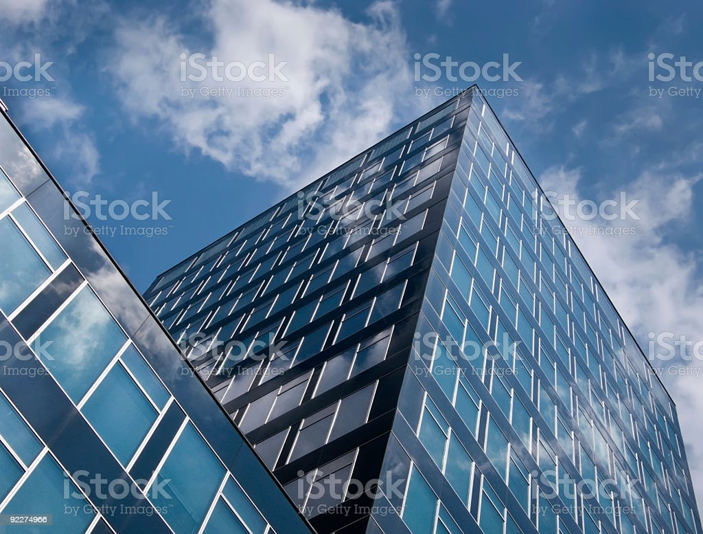 Modern high rise with cloud reflecting windows stock photo