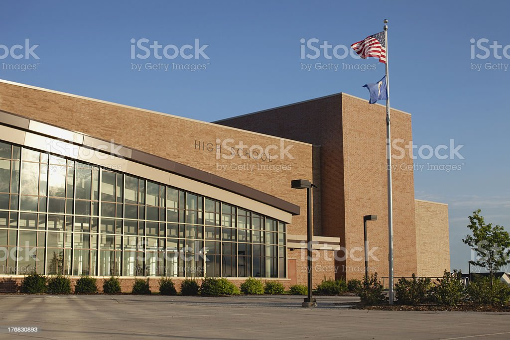 Modern high school with flagpole stock photo