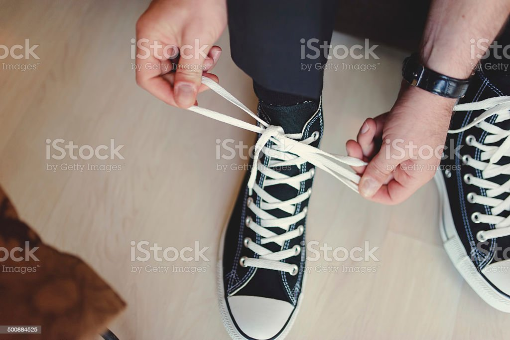 Modern hipster wedding, groom wearing sneakers stock photo