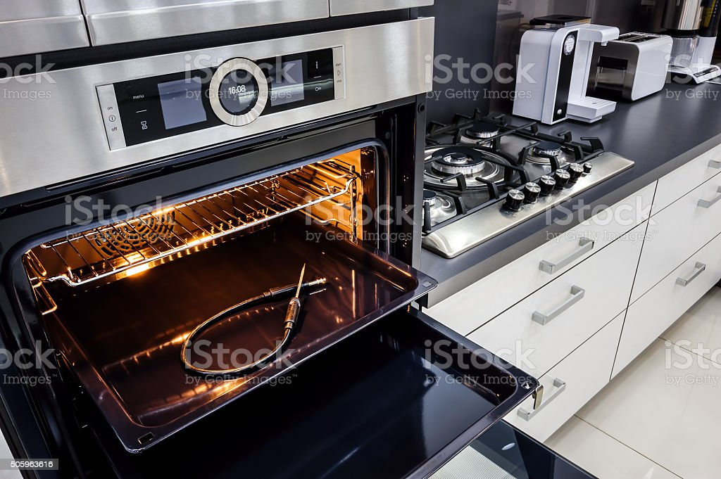 Modern hi-tek kitchen, oven with door open stock photo