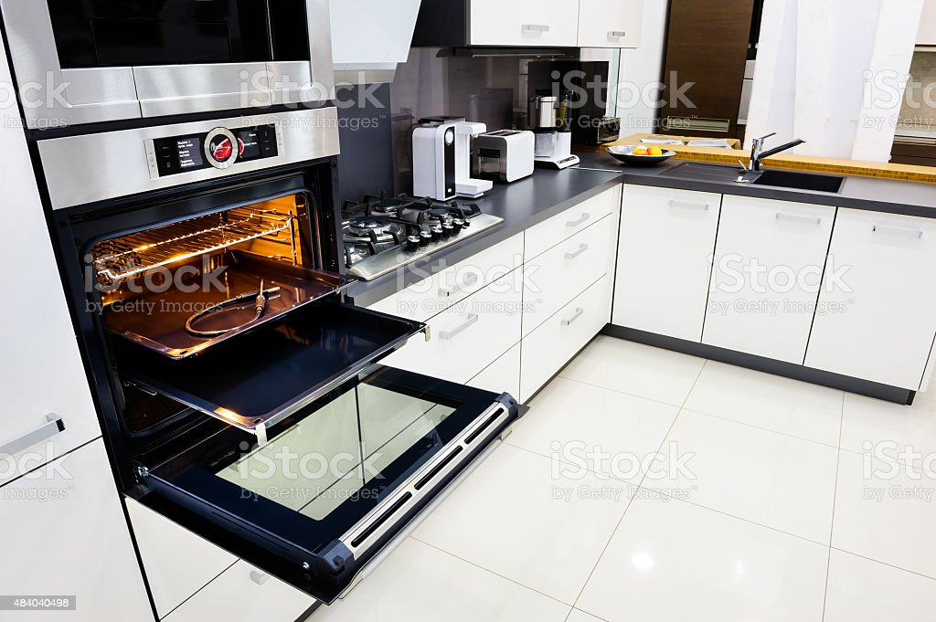 Modern hi-tek kitchen, oven with open door stock photo