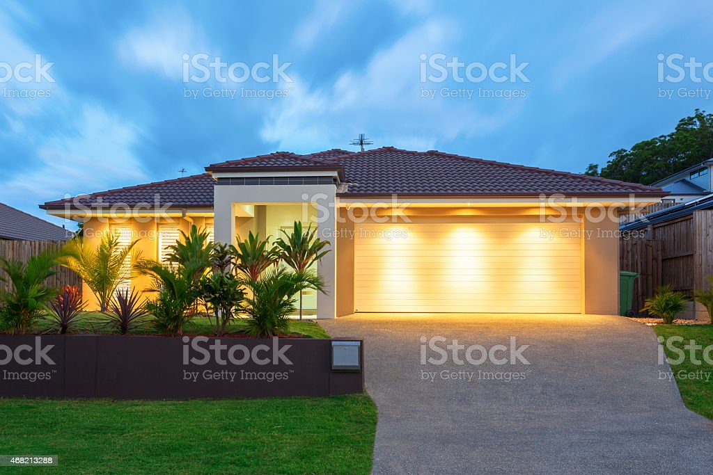 Modern home at dusk stock photo