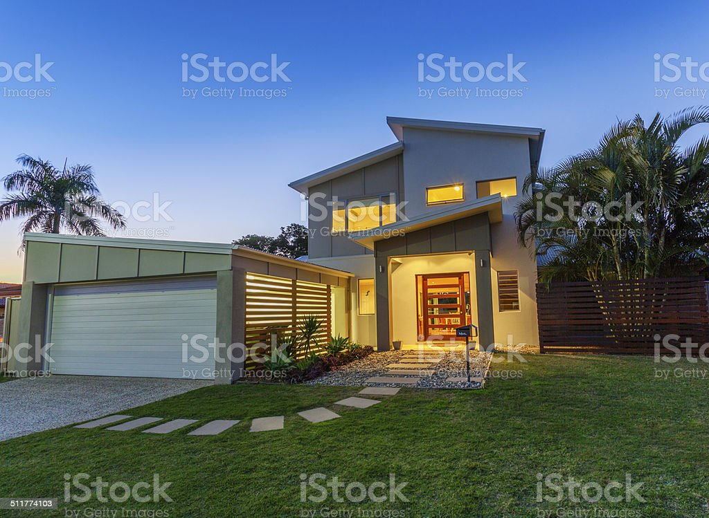 Modern home at dusk stock photo