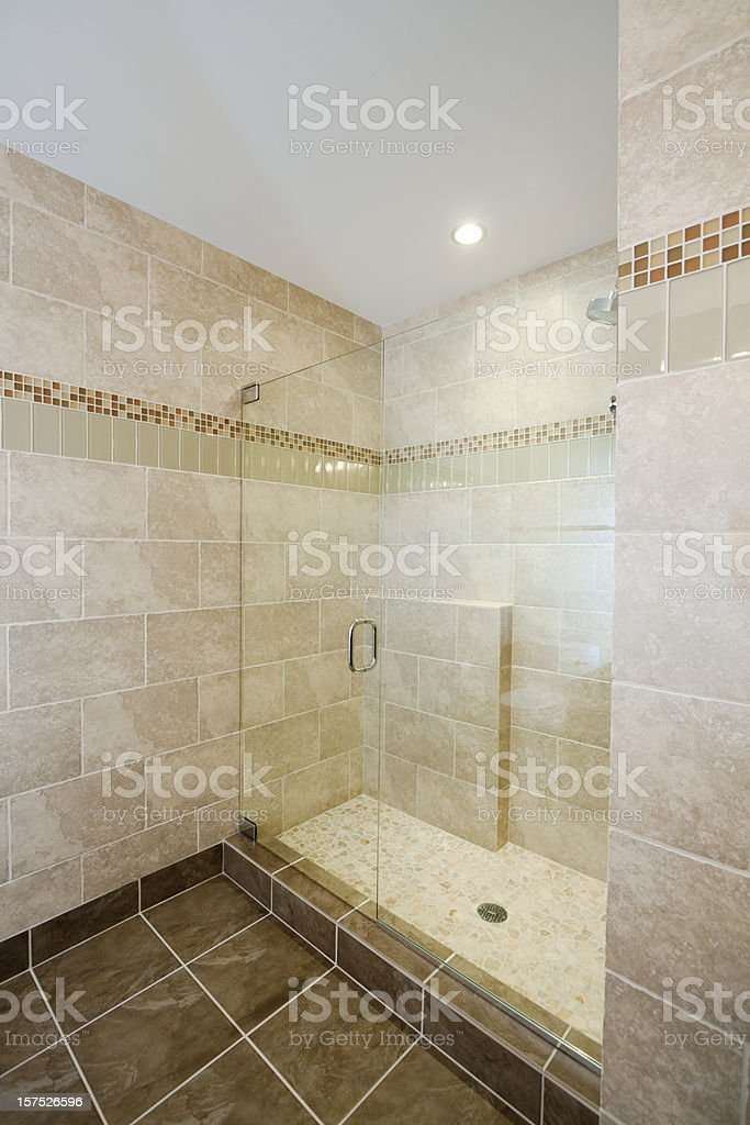 Modern Home Bathroom Shower with Glass Door, Tile and Marble stock photo