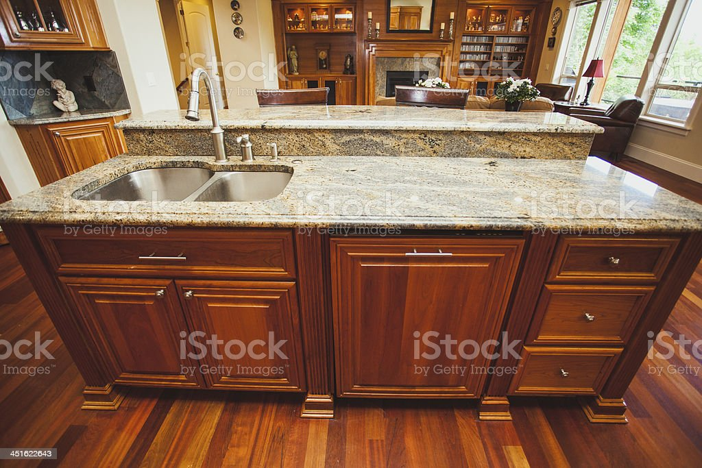 A clean spacious modern home kitchen with beautiful clean counter top...