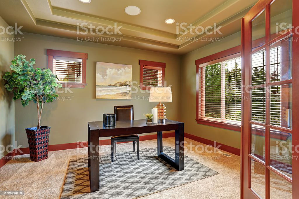 Modern home office interior with well designed wooden desk. stock photo
