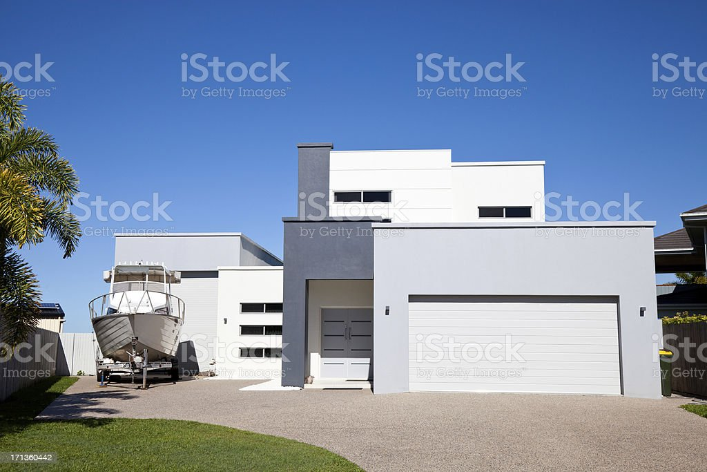 Modern Home with Boat royalty-free stock photo