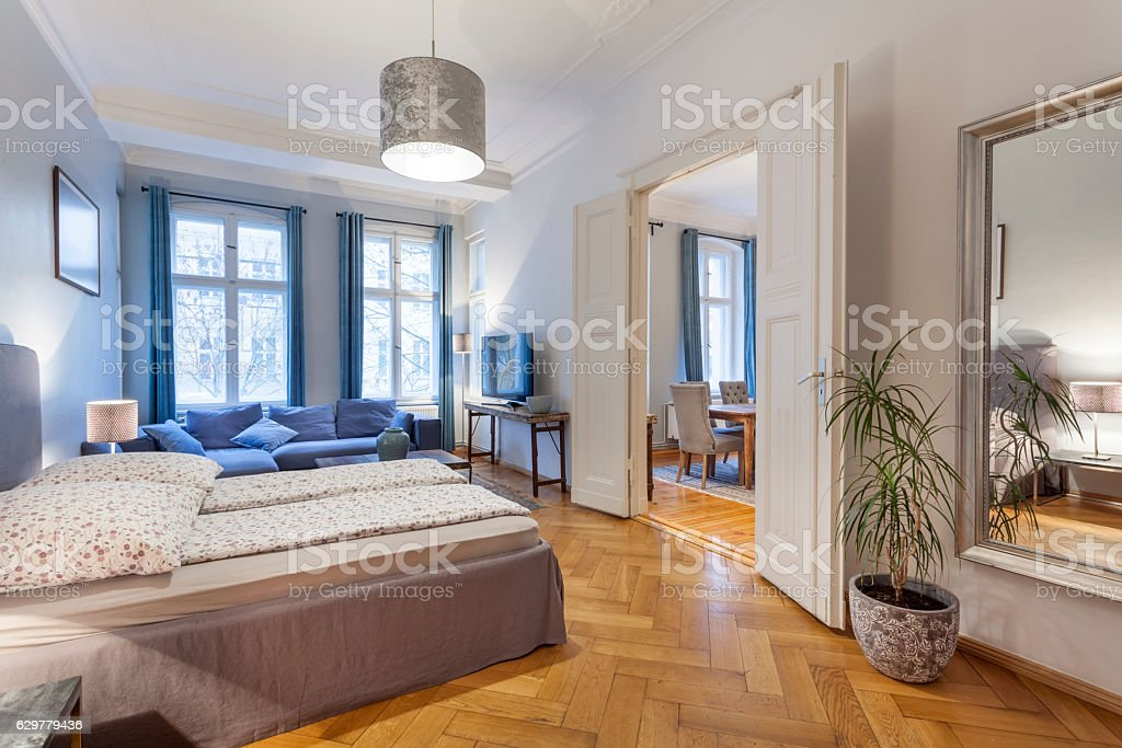 Modern Home With Double Doors Between Bedroom And Living Room Royalty Free Stock Photo