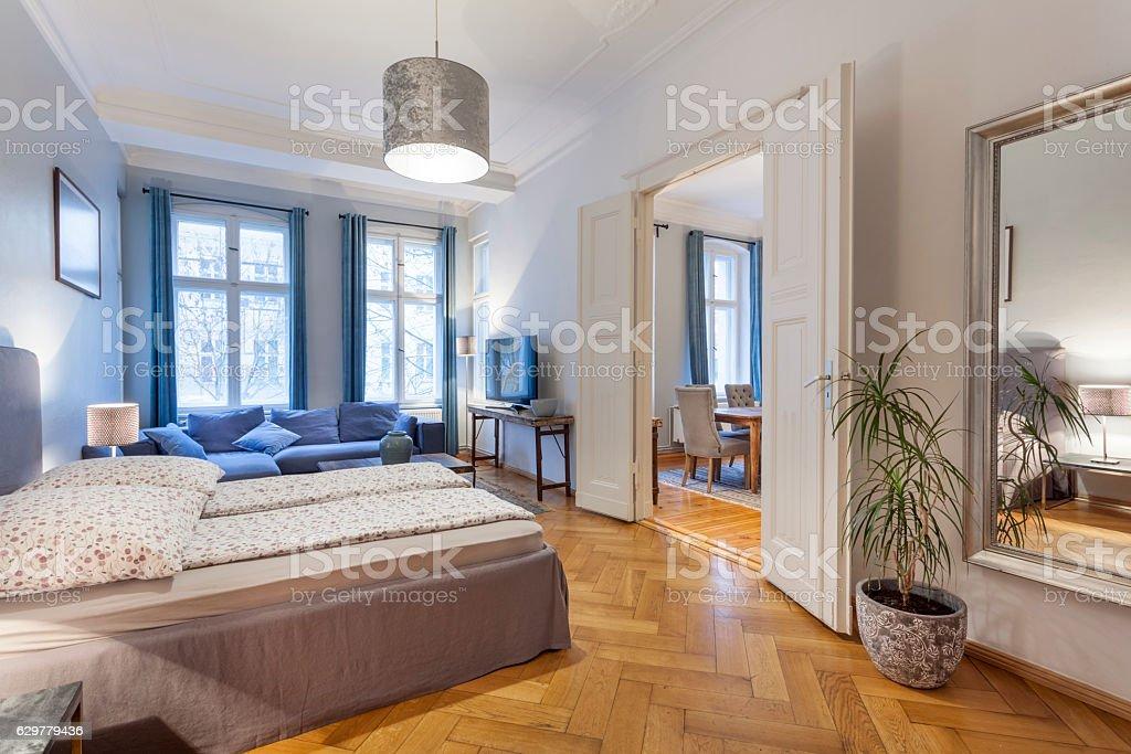 Modern Home with Double Doors between Bedroom and Living Room stock photo