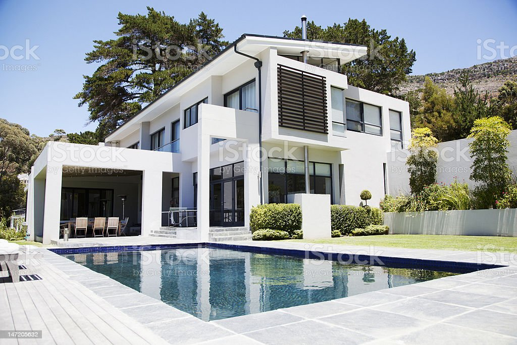 Modern home with swimming pool stock photo