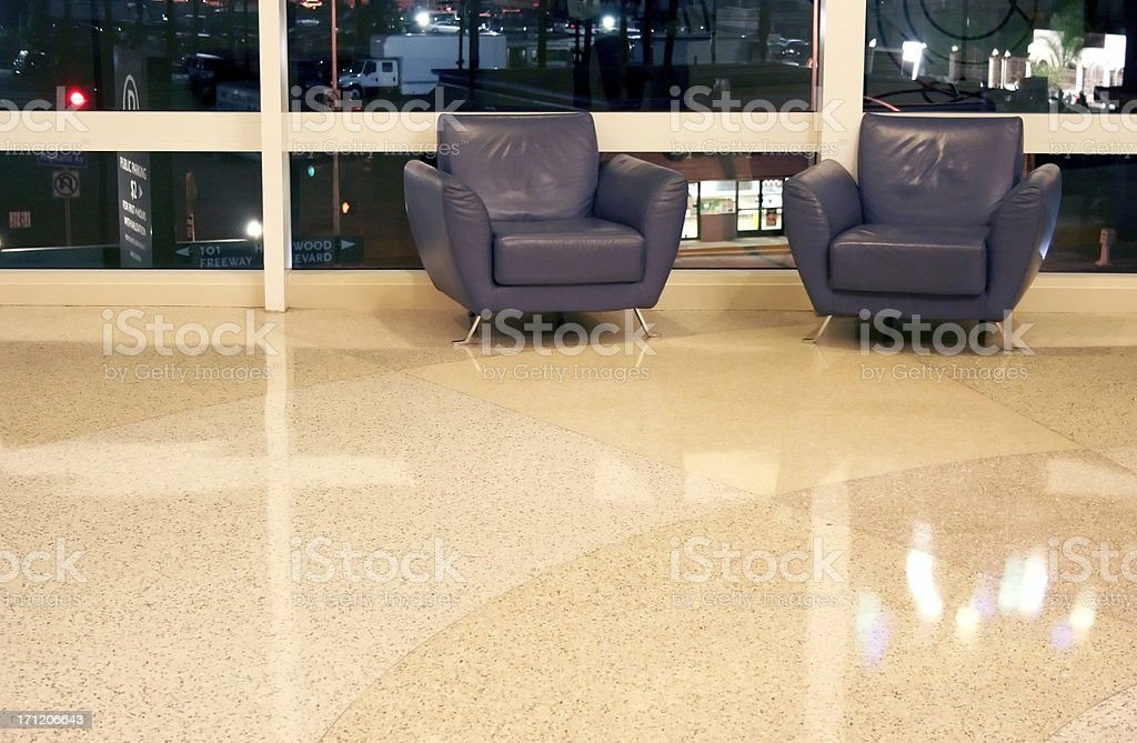 Modern Hotel Lobby with Blue Leather Chairs stock photo