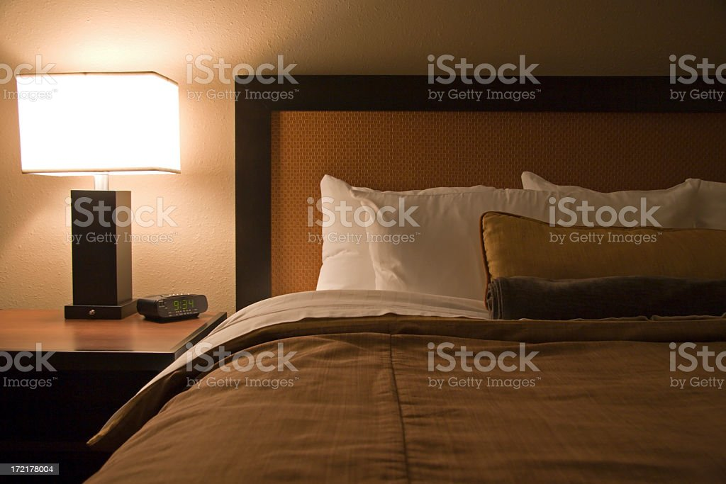A modern hotel room with the bed and night stand royalty-free stock photo